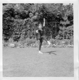 black & white photo of sonia as a child doing ballet in the garden